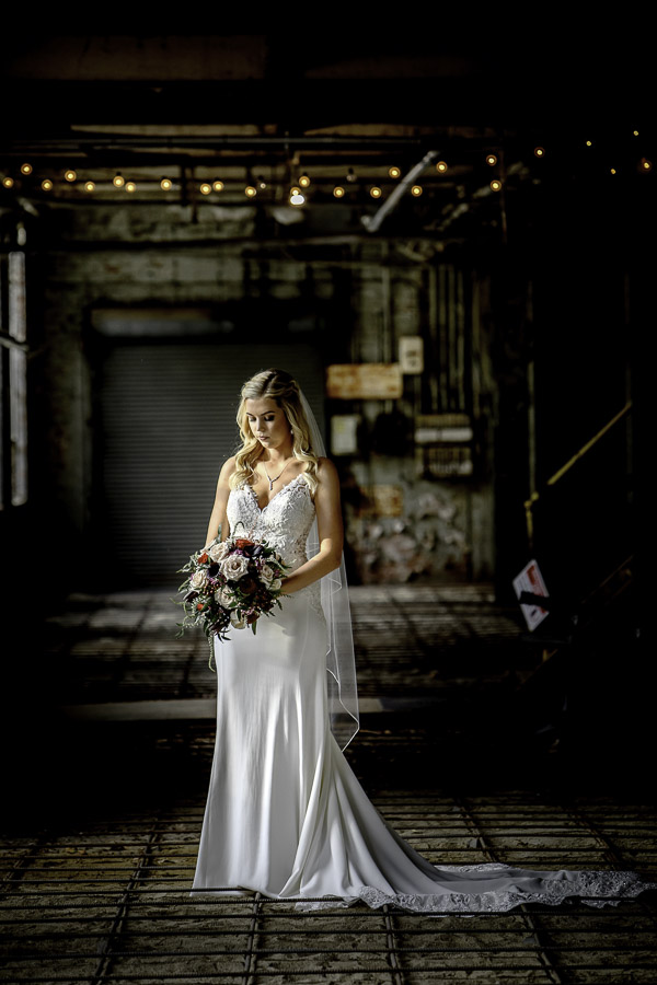 bride in a bright spot of an old and dark building